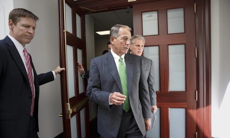 House Speaker John Boehner, R-Ohio., and Majority Leader Rep. Kevin McCarthy, R-Calif., emerge from a meeting with fellow Republicans on Capitol Hill.