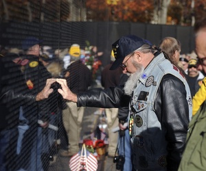 A Vietnam War veteran participates in a ceremony during the 2013 Veterans Day event at the Vietnam War Memorial in Washington, D.C.