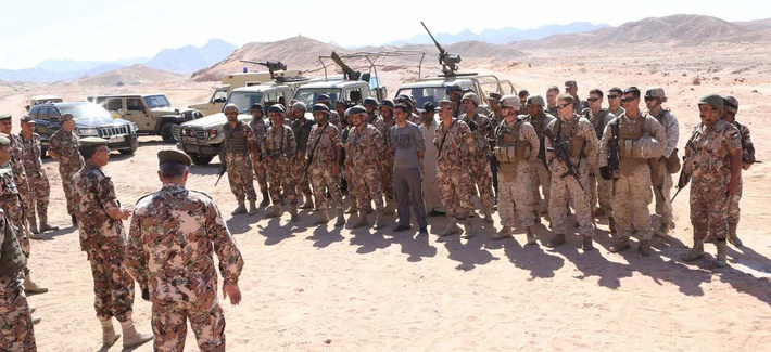 Jordanian Armed Forces Brigadier Gen. Ya'agoub Ajarmah congratulations Marines and members of Jordan's Armed forces for a border security exercise as part of Eager Lion 2014.