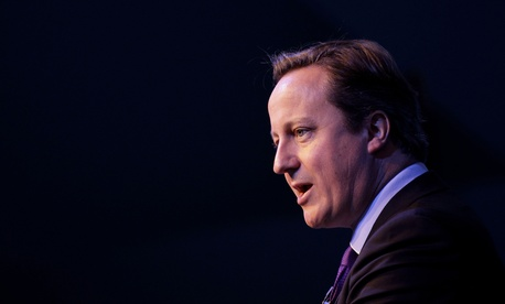 """British Prime Minister David Cameron, shown here in Belfast, Northern Ireland on Oct. 11, 2013, condemned the beheading of British aid worker David Haines by Islamic State militants as """"an act of pure evil."""""""