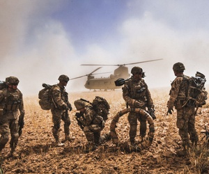 Soldiers with the 82nd Airborne Division gather their equipment before boarding a CH-47 Chinook in Nawa Valley, Kandahar Province, Afghanistan.