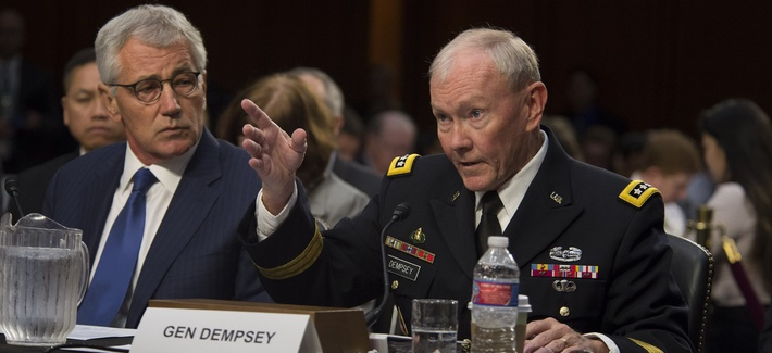 Defense Secretary Chuck Hagel and Joint Chiefs Chairman Gen. Martin Dempsey testify before the Senate Armed Services Committee on the threat of the Islamic State, on Sept. 16, 2014.