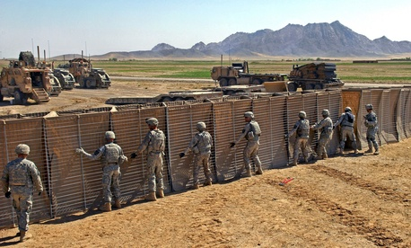 U.S. Army Soldiers construct a police checkpoint in Robat, Afghanistan, on March 19, 2010.