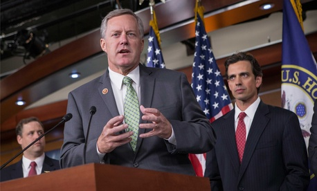 Rep. Mark Meadows, R-N.C., and Rep. Tom Graves, R-Ga., speak to reporters during a press conference on Capitol Hill, on September 19, 2013.