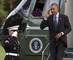 President Obama arrives on the South Lawn of the White House after traveling to Fort McHenry in Baltimore, on September 12, 2014.