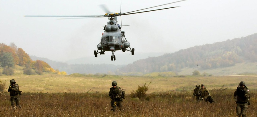 U.S. and Polish Special Operations Forces move across a field in Hohenfels, Germany, during a training exercise at the Joint Multinational Readiness Center.