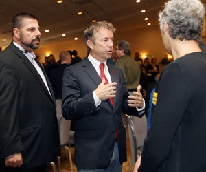 Sen. Rand Paul, R-Ky., talks with Republicans at an event in Manchester, N.H.