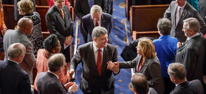 Ukrainian President Petro Poroshenko greets members of Congress after addressing a joint session of the legislature on Thursday.