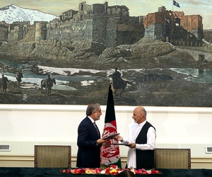 Afghanistan's presidential election candidates Abdullah Abdullah (left) and Ashraf Ghani (center), hold their documents after signing a power-sharing deal at the presidential palace in Kabul, Afghanistan.