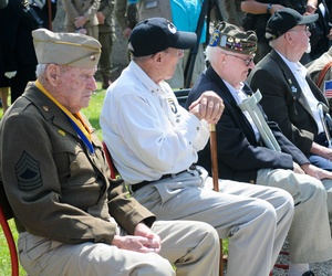 Military retirees watch the stage during a ceremony at Fort Bliss, Texas, on June 2, 2012.