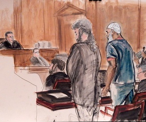 In this courtroom illustration, Sulaiman Abu Ghaith, center right, stands next to his attorney during his sentencing hearing in New York, on September 23, 2014.