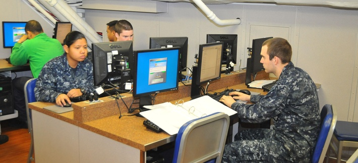 Sailors use computers to check their personal emails aboard the USS Carl Vinson.