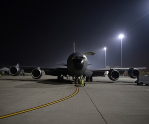 An Air Force KC-135 Stratotanker receives pre-flight checks before taking off from a base in the U.S. Central Command Area of Responsibility in support of a mission to conduct air strikes in Syria, Sept. 23, 2014.