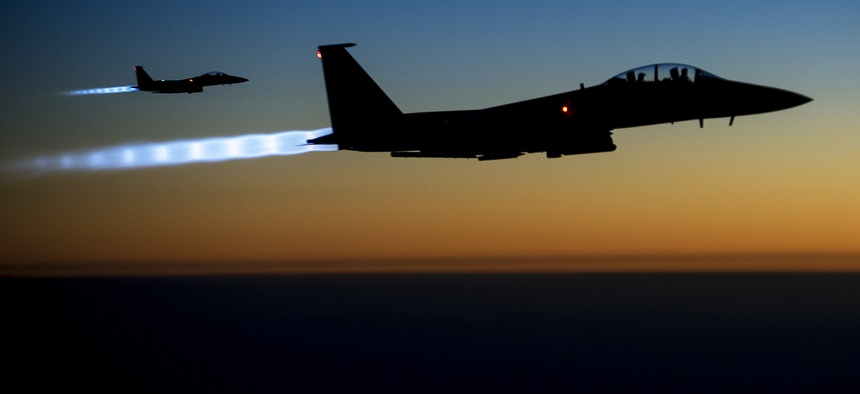 Two U.S. Air Force F-15E's fly over northern Iraq after conducting strikes against ISIL targets in Syria.
