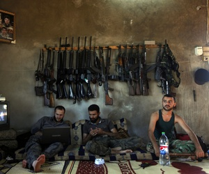 Free Syrian Army fighters sit in a house on the outskirts of Aleppo, Syria.