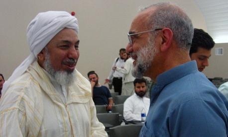 Sheikh Abdullah bin Bayyah, left, during a visit to Canada on January 5, 2012.