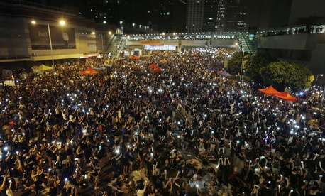 Protestors chant slogans near Hong Kong's government headquarters in protest of Beijings authority over the city, on September 30, 2014.
