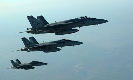 A formation of U.S. Navy F-18s leaves after receiving fuel from a KC-135 Stratotanker over northern Iraq, on September 23, 2014.