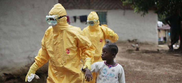 Nowa Paye, 9, is taken to an ambulance after showing signs of the Ebola infection in the village of Freeman Reserve, about 30 miles north of Monrovia, Liberia, on Tuesday Sept. 30.