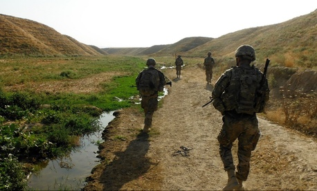 U.S. soldiers assigned to the 3rd Brigade Combat Team, patrol a seasonal river in Kunduz province, Afghanistan, on July 15, 2013.