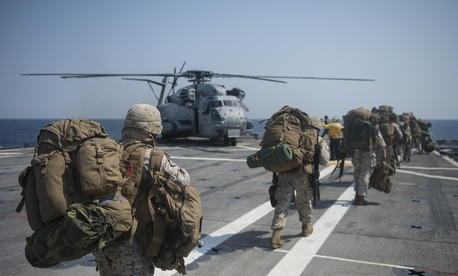 Marines assigned to the 31st Marine Expeditionary Unit load onto a CH-53E Super Stallion during Exercise Ssang Yong, on April 2, 2014.