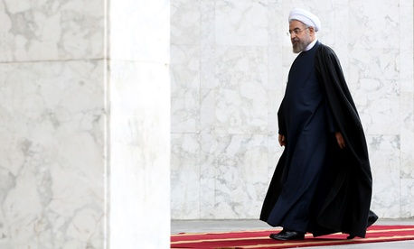 Iranian President Hassan Rouhani arrives for a welcoming ceremony for Azerbaijan's President Ilham Aliyev at the Saadabad Palace in Tehran, Iran, on April 9, 2014.