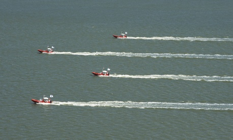 A group of autonomous swarm robots conduct operations on the James River.