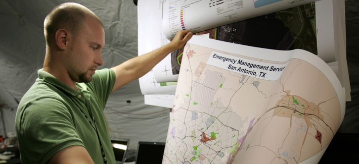 National Geospatial-Intelligence Agency analyst Kyle Schmidt looks over a map produced for emergency agencies in preparation for Hurricane Rita, Sept. 21, 2005 in New Orleans, La.