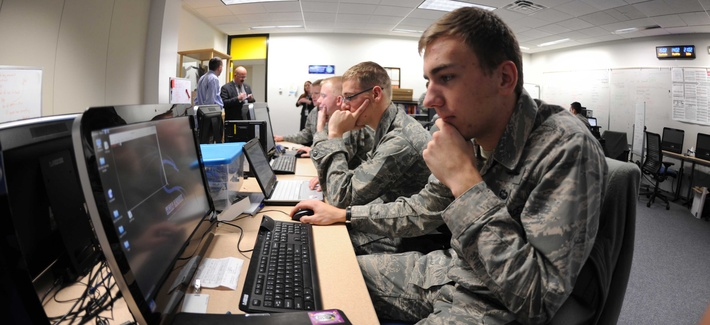 Members of the Air Force Academy's Cyber Competition team run through scenarios in preparation for an upcoming competition on December 10, 2013.