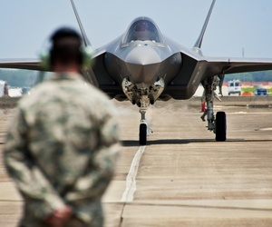 An Air Force F-35 approaches an airman at Eglin Air Force Base, on July 14, 2011.