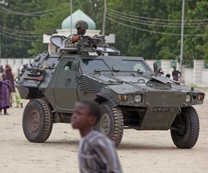 A Nigerian soldier patrols in an armored car in Maiduguri, Nigeria, on August 8, 2013.