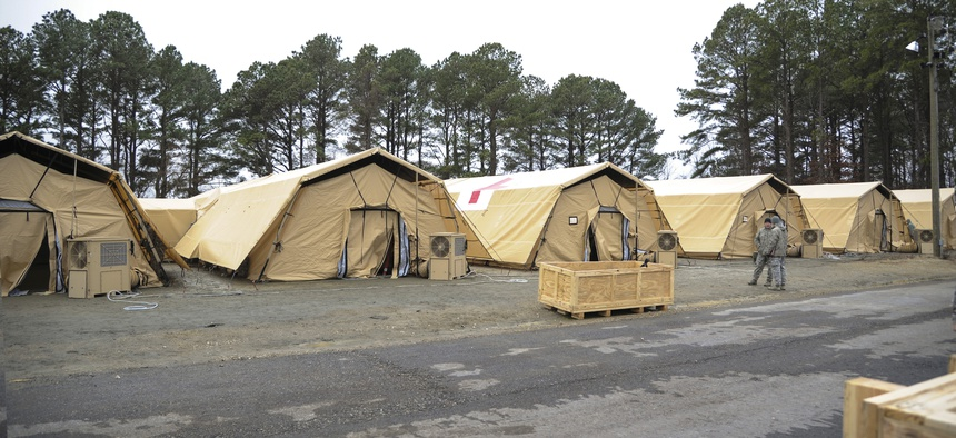Teams from the 633rd Medical Group team up with the San Antonio Military Medical Center at Langley AFB to test a new tent structure for the Expeditionary Medical Support System, on February 3, 2014.