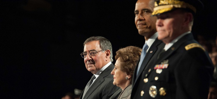 Former Defense Secretary Leon Panetta stands with President Obama and Joint Chiefs Chairman Gen. Martin Dempsey during a farewell tribute at Joint Base Meyer-Henderson Hall, on February 8, 2013.