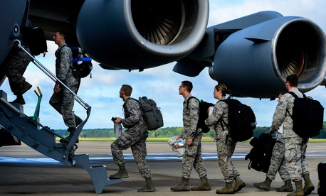 Airmen assigned to the 633rd Medical Group load onto a C-17 Globemaster at Langley Air Force Base prior to a deployment to Ebola-stricken African countries.