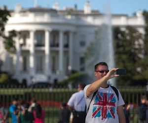 A man takes a selfie in front of the White House, on September 22, 2014.