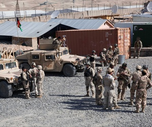 Patrolmen with the Provincial Response Company, Task Unit Wardak, prepare for a humanitarian assistance patrol at Forward Operating Base Airborne, Wardak province, on March 27, 2014.