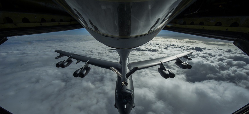 A B-52 Stratofortress is refueled in-flight over the Pacific Ocean near Joint Base Pearl Harbor-Hickam, on April 2, 2014.