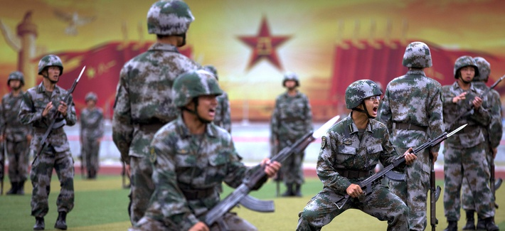 Chinese People's Liberation Army cadets shout as they take part in bayonet drills at the Armored Forces Engineering Academy Base, outside of Beijing, China.