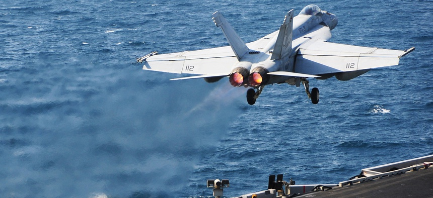 An F/A 18 Super Hornet launches from the flight deck of the USS George H.W. Bush while supporting operations against ISIS, on October 13, 2014.