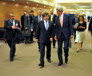 Secretary of State John Kerry and then-Turkish Foreign Minister Ahmet Davutoglu walk to a bilateral meeting at NATO Headquarters in Brussels, Belgium.