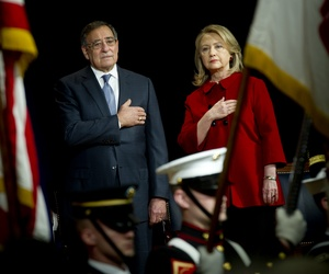 Former Defense Secretary Leon Panetta awards Hillary Clinton the Department of Defense Distinguished Civilian Service Award, on February 14, 2013.