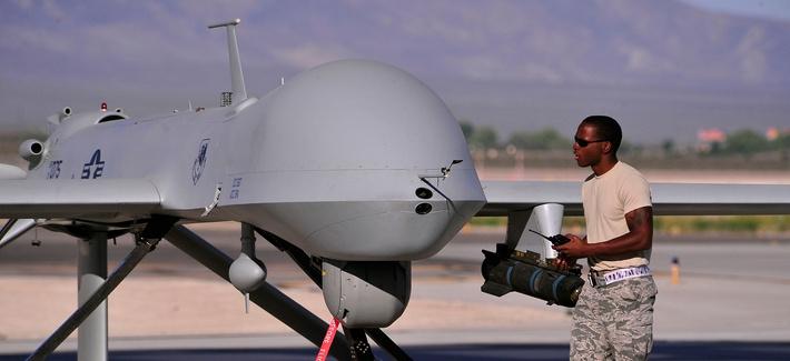 A crew chief prepares an MQ-1B Predator for a training mission.
