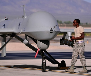 A crew chief prepares an MQ-1B Predator for a training mission.