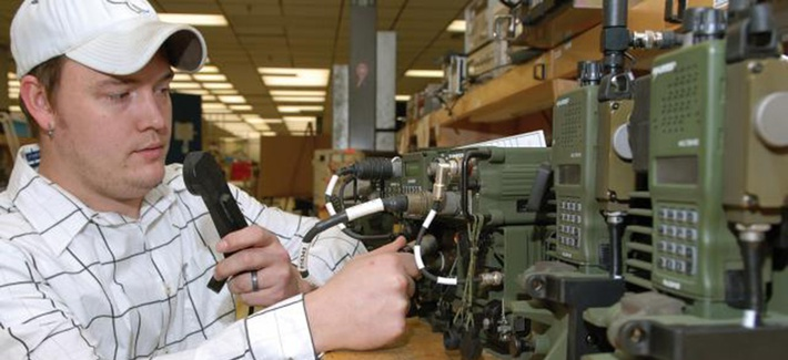 A technician at Tobyhanna Army Depot performs a system check on a series of radio systems.
