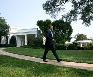 President Obama walks to the podium on the South Lawn of the White House to deliver a statement on the situation in Iraq, on August 9, 2014.
