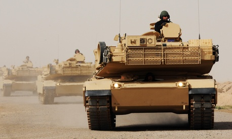 An Iraqi Army soldier learns how to drive an M1A1 Abrams Battle Tank as part of an armored column.