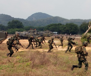 Royal Thai Marines hit the beach and move towards their objectives during an amphibious assault demonstration alongside U.S. Marines during Exercise Cobra Gold 13.