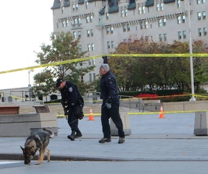 Canadian officers patrol during a moment of silence held for Corporal Nathan Cirillo, the soldier killed during an attack at Ottawa's National War Memorial, on Wednesday.