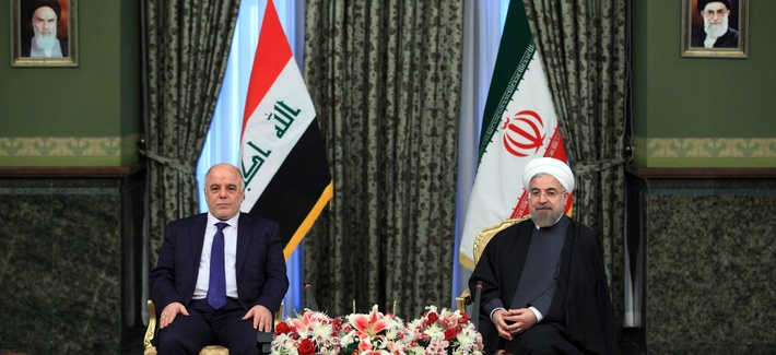 Iraqi Prime Minister Haidar al-Abadi (left) meets with Iran's President Hassan Rouhani at Tehran's Saadabad Palace, on October 21, 2014.