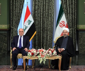 Iraqi Prime Minister Haidar al-Abadi (left) meets with Iran's President Hassan Rouhani at Tehran's Saadabad Palace, on October 21, 2014.